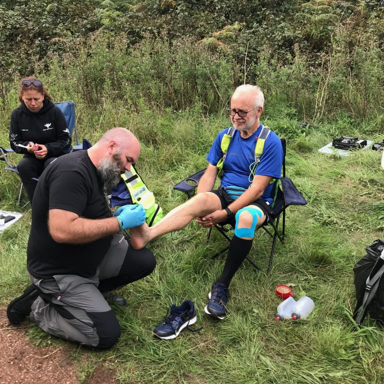 Foot care at aid station 6 on the Robin Hood 100 ultramarathon