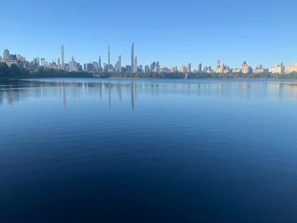 View looking back into Manhattan from Central Park reservoir while on a run